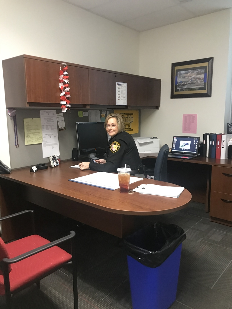 Deputy Grogg starting her day off in her office.